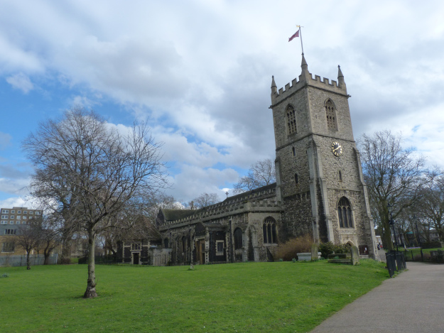 Essentially Medieval exterior of church of St Dunstan and All Saints, with Red Ensign flying from tower